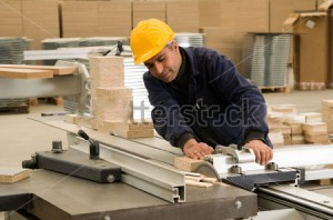stock-photo-carpenter-cutting-wood-on-electric-saw-focus-is-on-the-blade-of-the-tool-a-series-of-industrial-75661117