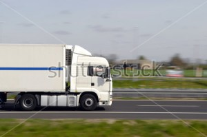stock-photo-truck-with-freight-moving-fast-3128006